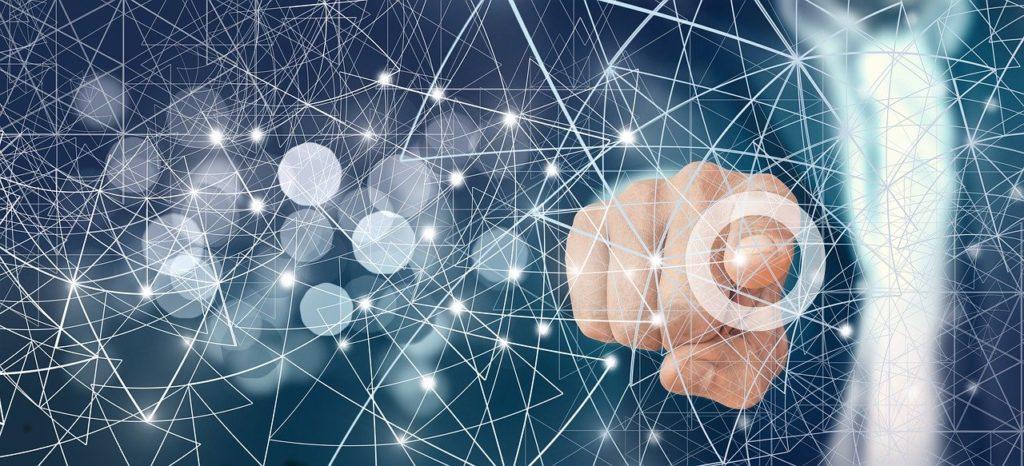 Digitalisierung Symolbild: Hand zeigt auf Netz